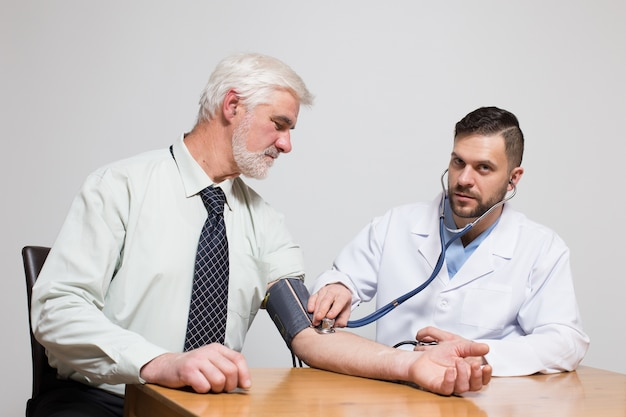 Pressure arm his health pensioner hand