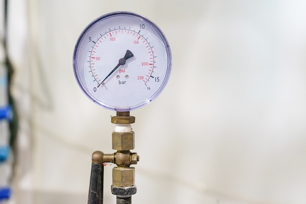 Pressure gauge, pressure gauge for monitor condition. pipes and valves at pharmacy factory
