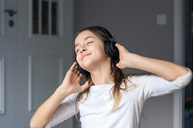 Preteen girl enjoying listening to music