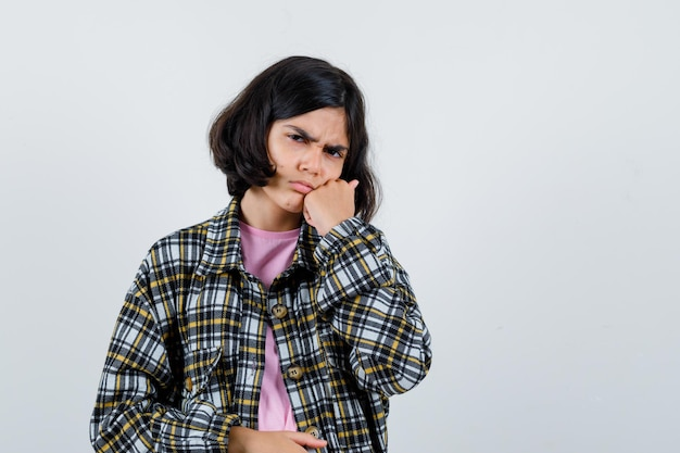 Preteen girl suffering from toothache in shirt,jacket front view.