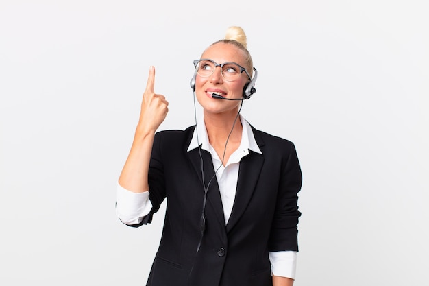 Pretty adult woman with a headset working