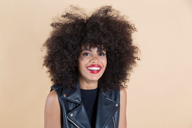 Pretty afro american woman smiling with leather clothes