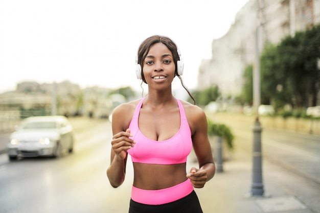 Pretty afro girl jogging