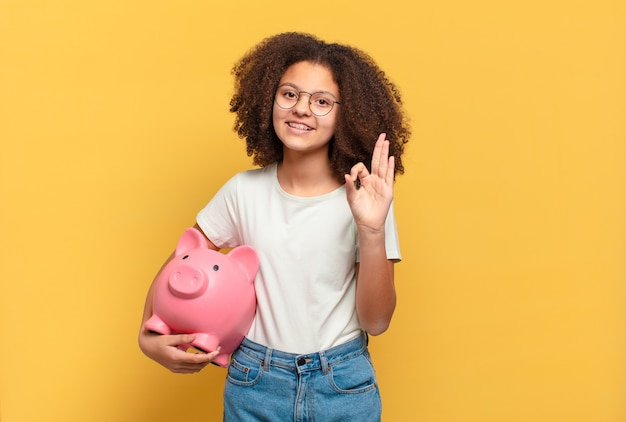 Pretty afro teenager looking very shocked or surprised, staring with open mouth saying wow. savings concept