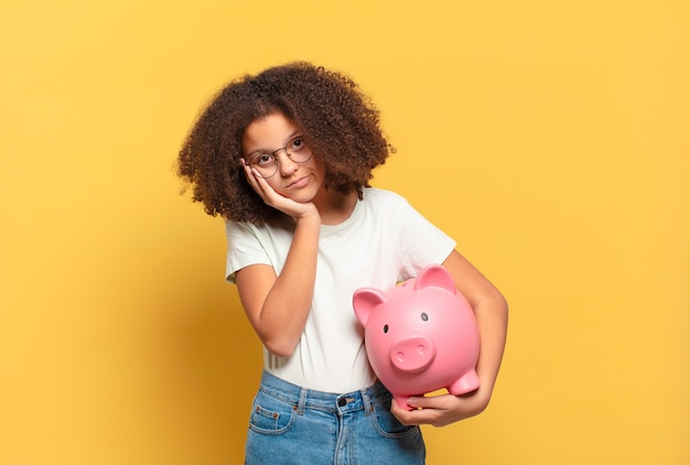 Pretty afro teenager open-mouthed and amazed, shocked and astonished with an unbelievable surprise. savings concept
