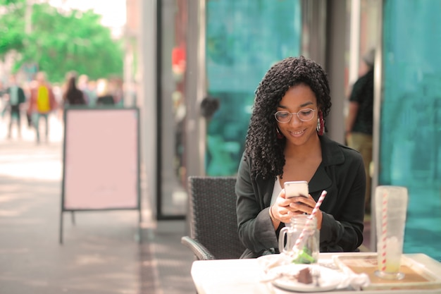 Pretty afro woman texting