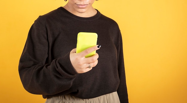 Pretty afro woman typing on smartphone
