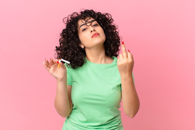 Pretty arab woman feeling angry, annoyed, rebellious and aggressive. no smoking concept