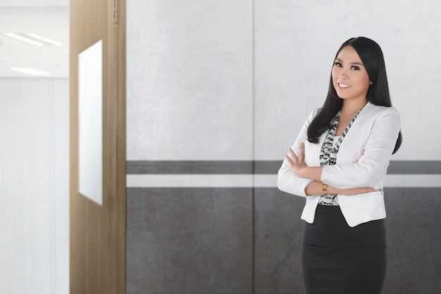 Pretty asian female teacher standing