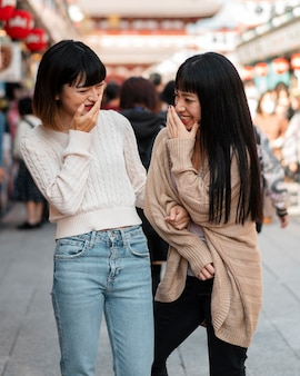 Pretty asian girls laughing together