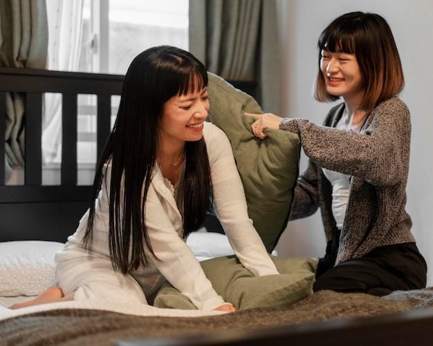 Pretty asian girls pillow fighting