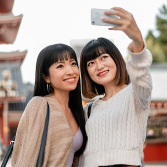 Pretty asian girls taking a selfie together