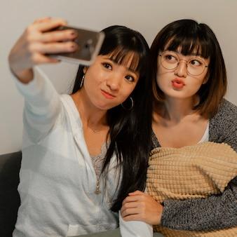 Pretty asian girls taking a selfie