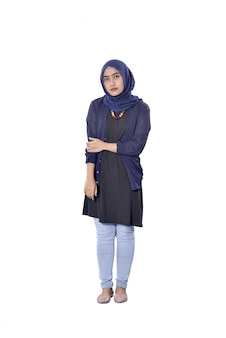 Pretty asian muslim woman standing