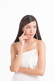 Pretty asian woman portrait with long straight hair on white