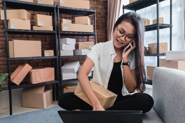 Pretty asian woman receiving online order