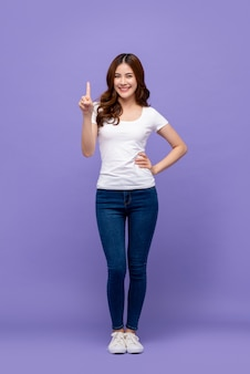 Pretty asian woman smiling and pointing finger up