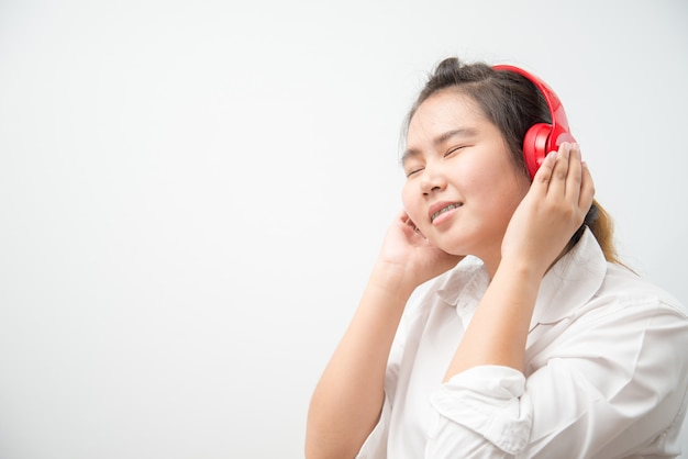 Pretty asian young girl listening music with her headphones