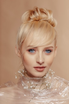 Pretty attractive girl with blond hair, fashion shooting, rose