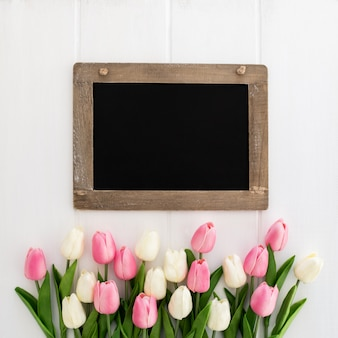 Pretty blackboard with bouquet of tulips