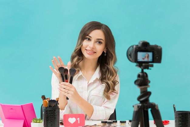 Pretty blogger recording make-up video
