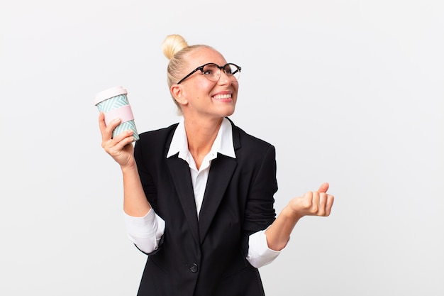 Pretty blond adult businesswoman with a take away coffee