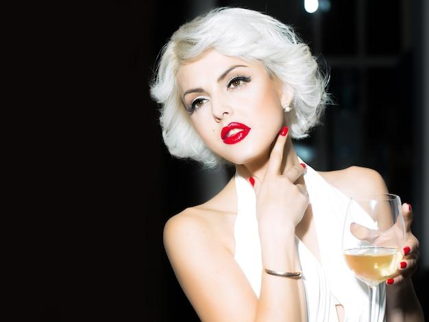 Pretty blond girl model like marilyn monroe in red lips