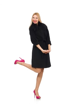 Pretty blond woman in black coat isolated on white