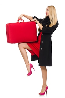 Pretty blond woman holding suitcase isolated on white