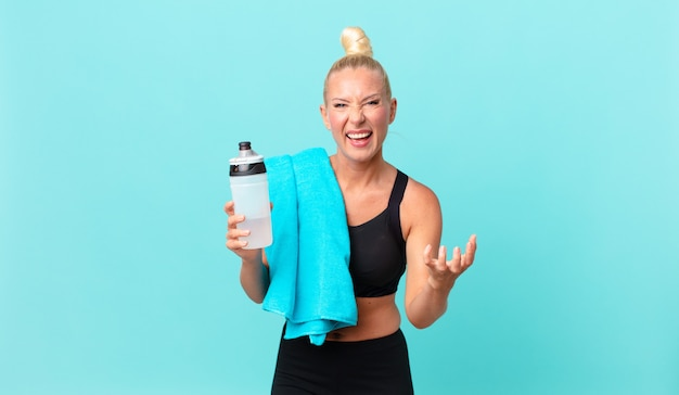 Pretty blond woman looking desperate, frustrated and stressed. fitness concept