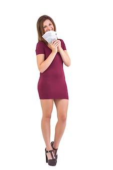 Pretty blonde in burgundy dress showing her cash