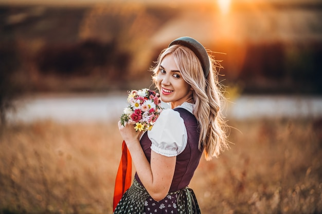 Pretty blonde in traditional oktoberfest dress