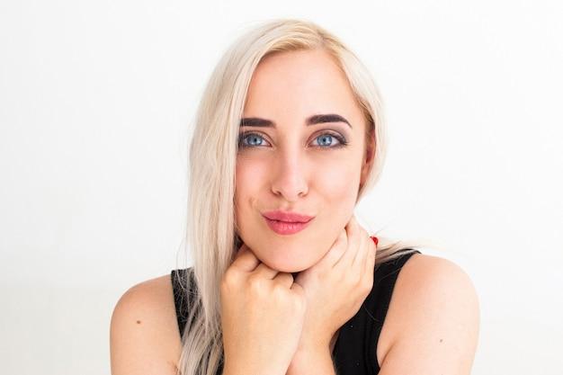 Pretty blonde woman flirting on camera sending air kiss