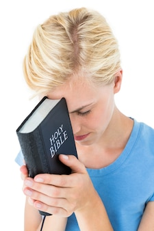 Pretty blonde woman holding bible