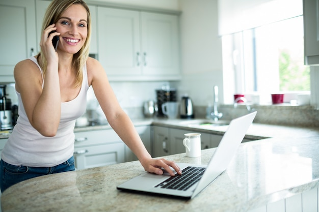 Pretty blonde woman looking at laptop