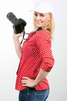 Pretty blonde woman photographer with  camera, on white