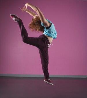 Pretty break dancer leaping mid air