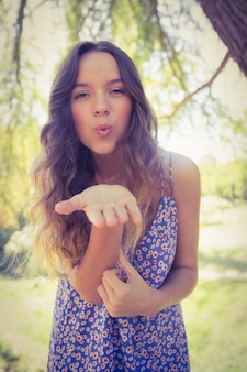 Pretty brunette blowing kiss at camera