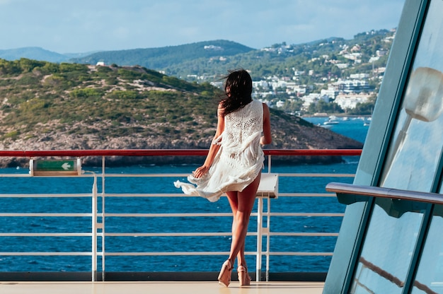 Pretty brunette female enjoying summer sea cruise