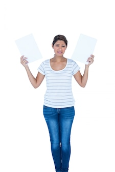 A pretty brunette holding papers on white background