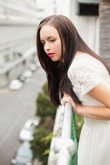 Pretty brunette looking over the balcony