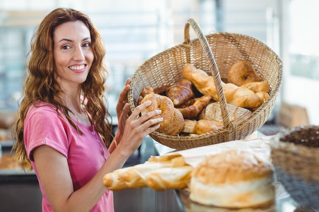 Pretty brunette picking out croissant