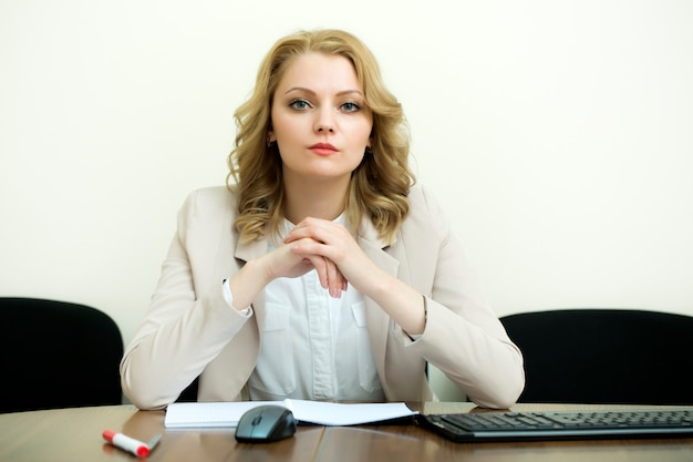 Pretty business woman at table