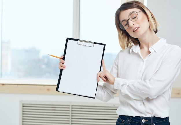 Pretty business woman in white shirt office documents professional