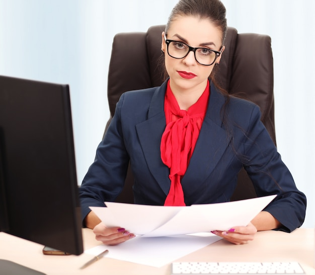 Pretty business woman working in the office