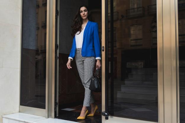 Pretty businesswoman leaving work