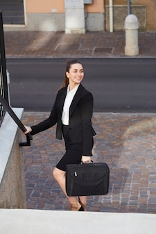 Pretty businesswoman at the stairs