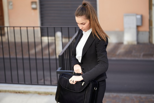 Pretty businesswoman at the street