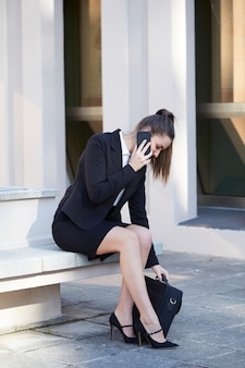 Pretty businesswoman talking at the phone