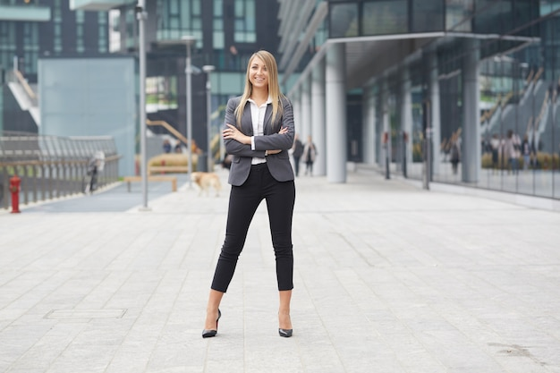 Pretty businesswoman in urban environment